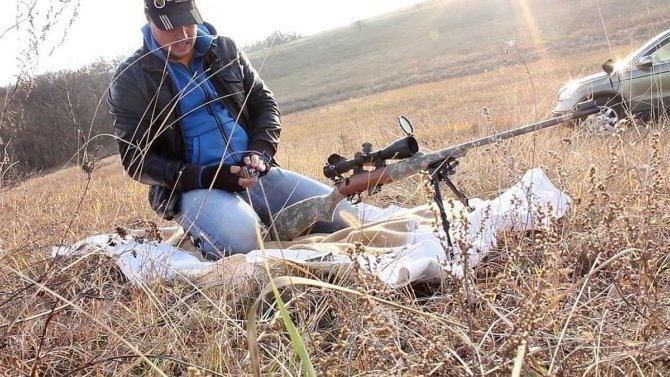 Охотник с мелкокалиберной винтовкой